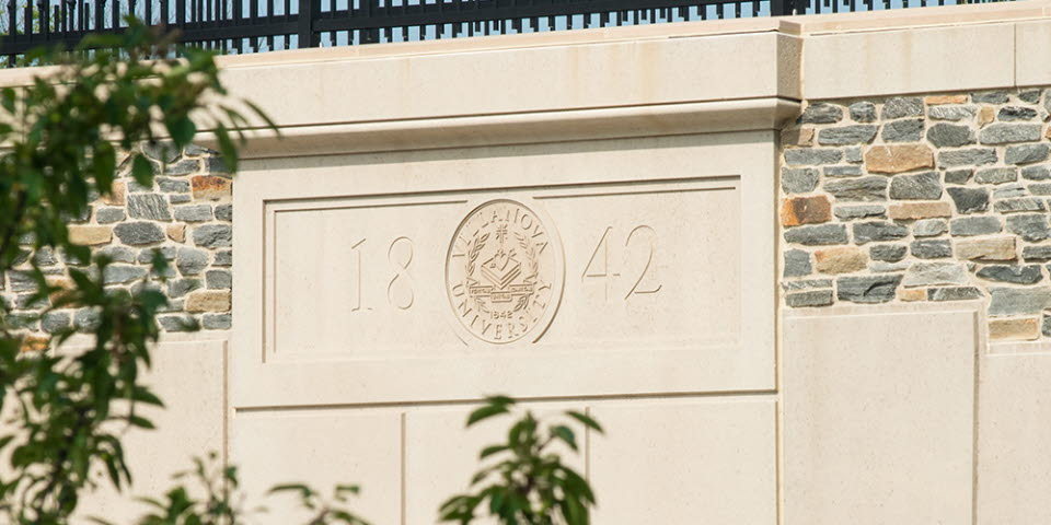 1842 and Villanova Seal on Pedestrian Bridge in concrete