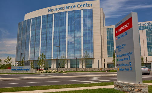 Front View of Riverside Neuroscience Center with Parking Sign