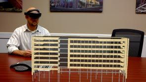 Rob Heagy, director of drafting services at High Concrete Group LLC, looks at an augmented reality model through a Microsoft HoloLens.